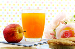 Orange juice and red apple. On sweet polka dot background Stock Photography