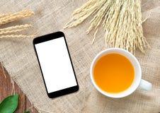Orange juice with rice drying on Sackcloth background. Royalty Free Stock Photos