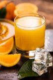 Orange juice with a rusitc setup stock photo