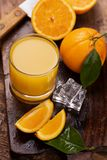 Orange juice with a rusitc setup stock image