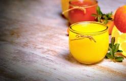 Orange juice on rustic table Stock Image