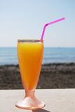 Orange juice by the sea, Lagos. Royalty Free Stock Images