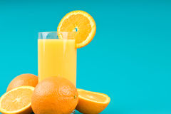 Orange juice with slice of orange. Healthy breakfast diet orange juice with slice of orange on bright blue background. Source of vitamin C Royalty Free Stock Images