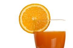 Orange juice with sliced citrus as a decoration Stock Image