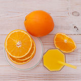 Orange juice with sliced orange half on wooden Stock Photo