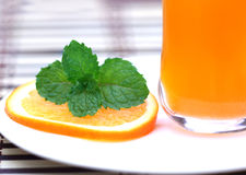 Orange juice with sliced orange and mint leaves Royalty Free Stock Photo