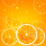 Orange juice. With orange slices and bubbles Royalty Free Stock Images