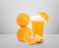Orange juice and slices Royalty Free Stock Image