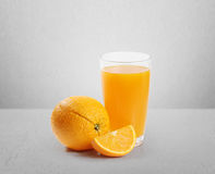 Orange juice and slices Stock Photos