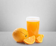 Orange juice and slices Royalty Free Stock Photo