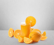 Orange juice and slices Royalty Free Stock Images