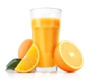 Orange juice and slices Stock Image