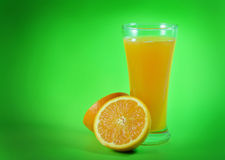 Orange juice and slices of orange. On green background Stock Photo