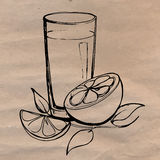 Orange juice with slices of orange and leaves hand drawn on the craft paper. Concept of healthy diet. Stock Images