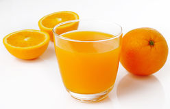 Orange juice and slices of orange Stock Photography