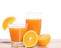 Orange juice and slices on wood Stock Image