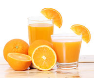 Orange juice and slices on wood Stock Photos