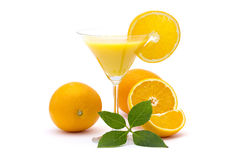 Orange juice and some fresh fruits. On white Royalty Free Stock Photos