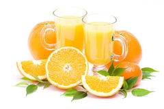 Orange juice and some fresh fruits. On white Stock Image