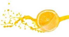 Orange juice splash. Isolated on white background Stock Photography