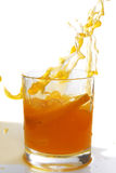 Orange juice splash. Orange juice big splash on white background Royalty Free Stock Photography