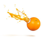 Orange juice splash. Orange with bottle neck and juice splashes stock photography