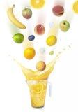 Orange juice splash with fruit rain Stock Images