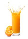 Orange juice splash. Glass of splashing orange juice with its fruits Royalty Free Stock Photography