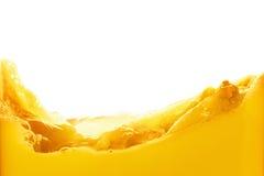 Orange juice splash isolated on white background. Healthy fresh drink, wave with drop Royalty Free Stock Photo