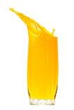 Orange juice splash isolated on white Royalty Free Stock Photography