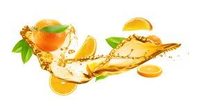 Orange juice splash with oranges isolated on the white backgrou. Nd Royalty Free Stock Image