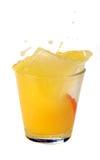 Orange juice splash. On a white background Royalty Free Stock Image