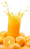 Orange juice splashing Stock Photography