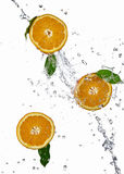 Orange juice splashing Royalty Free Stock Image