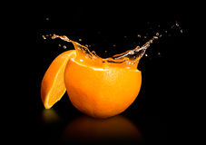 Orange juice splashing Royalty Free Stock Photo