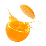 Orange juice splashing Royalty Free Stock Images
