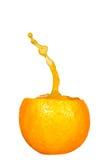 Orange juice splashing isolated on white Stock Photos