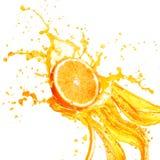 Orange juice splashing with its fruits isolated on white Royalty Free Stock Images