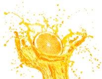 Orange juice splashing with its fruits isolated on white Stock Image