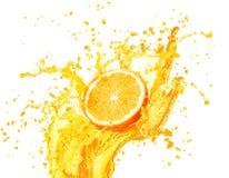 Orange juice splashing with its fruits isolated on white Royalty Free Stock Photography