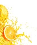 Orange juice splashing with its fruits  on white Stock Images