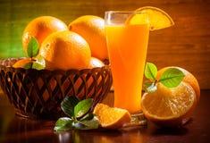 Orange juice. Sweet orange juice and fruits royalty free stock image
