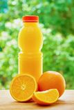 Orange and juice on the table Stock Images