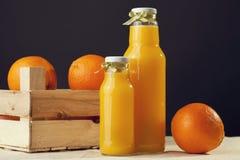 Orange juice on table close-up Stock Photos