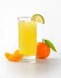 Orange juice and tangerine Royalty Free Stock Images