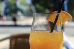 Orange juice in a terrace royalty free stock photography