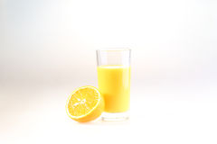 Orange juice in a transparent glass on a white background. Juice from fresh oranges royalty free stock photography