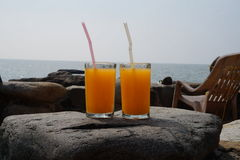 Orange juice for two. Two glasses of orange juice on the stone Stock Photos