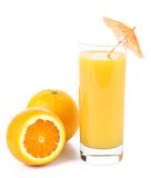 Orange juice and two oranges Royalty Free Stock Images