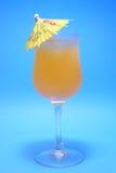 Orange Juice With Ubmrella. Orange Juice with umbrella on Blue background Royalty Free Stock Photography